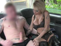 Busty tattooed blonde nailed in the cab