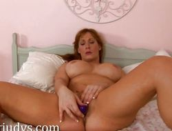 Angela James masturbates with a toy