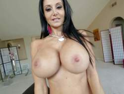 Topless milfyf brunette Ava Addams in panties and shoes is proud of her unthinkably huge melons. This babe shows off her killer boobs with smile on her face. This babe can't live without playing with her oiled up tatas
