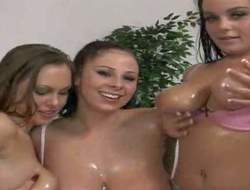 Gianna Michaels, Natasha Nice and their friend have fun in showing their big delightsome melons in front of the camera and playing with some body oil as well