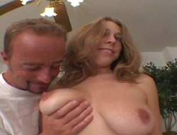 Carly Kaleb is s naturally busty chick that positions topless in front of a lucky man in the middle of the room. He touches her amazing biggest knockers over and over again. Enjoy!