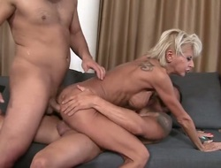 A hot milf is getting ass fucked during the time that she is giving a blow job. That babe likes to have sex in a threesome since then all her holes acquire filled up at once.