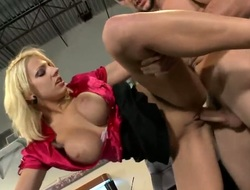Blonde Lylith Lavey with huge knockers and bald cookie lets man drill her sweet mouth