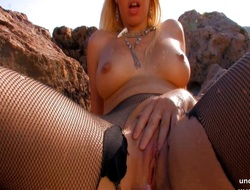 Busty blond whore banged hard and facialized on a beach