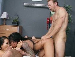 Asa Akira Christy Mack gets the gap between her legs drilled by mans rock hard cock in interracial porn act
