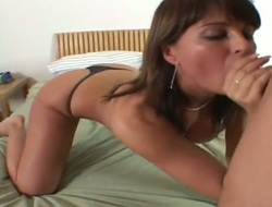 Brunette with massive melons and shaved pussy is on fire in tujob action