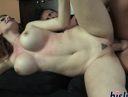 Busty redhead has her tits jizzed on