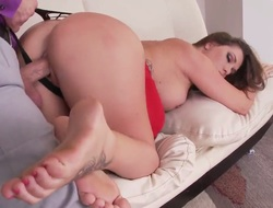 Brunette hair is massaging with her feet