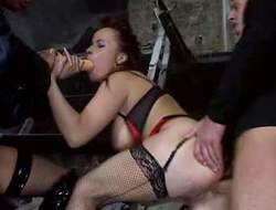 Busty redhead playgirl with large pale butt in her sexy lingerie and nylons enjoys in taking on two hard bazookas in her arousing threesome sex session in the back room
