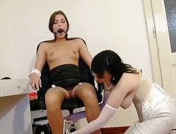 Hawt MILF demonstrates how to tie up a brunette chick