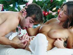 August Ames is a gorgeous big boobed brunette in white stockings that gives sexual joy to her man on Christmas. She gives headjob and gets her muff licked before she takes his pole in her gap